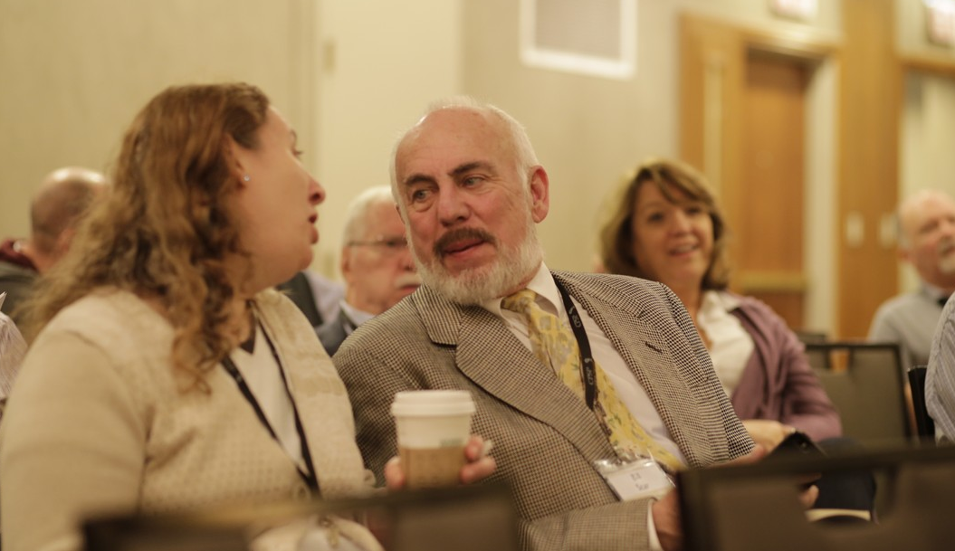 CPSP President Bill Scar (center) talks with a Plenary Attendee, Chicago, 2015